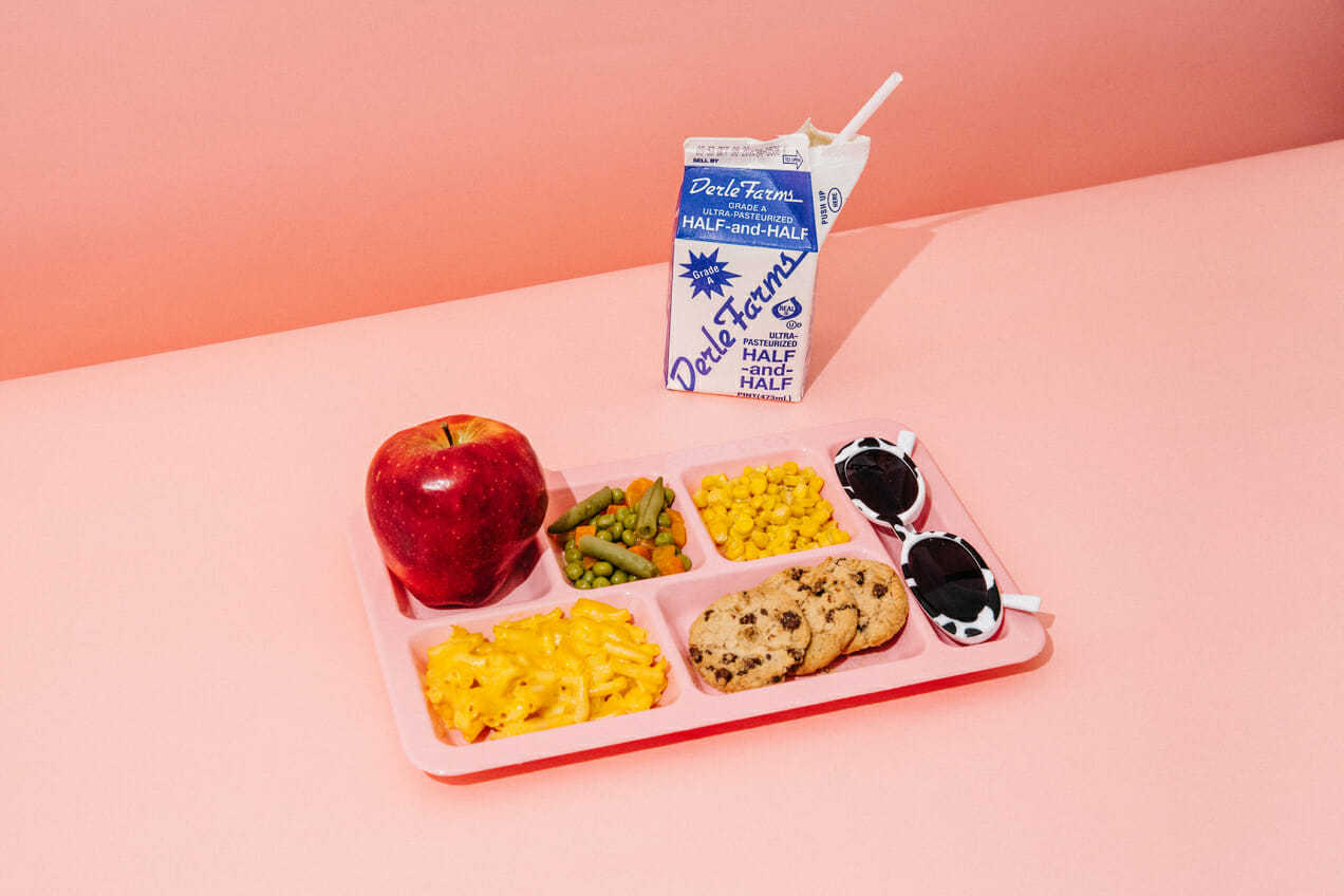 lunch tray apple cow sunglasses milk mac cheese cookie corn beans