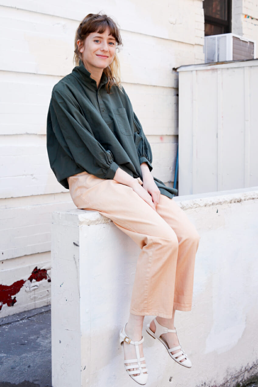 haley nahman green shirt beige pants portrait