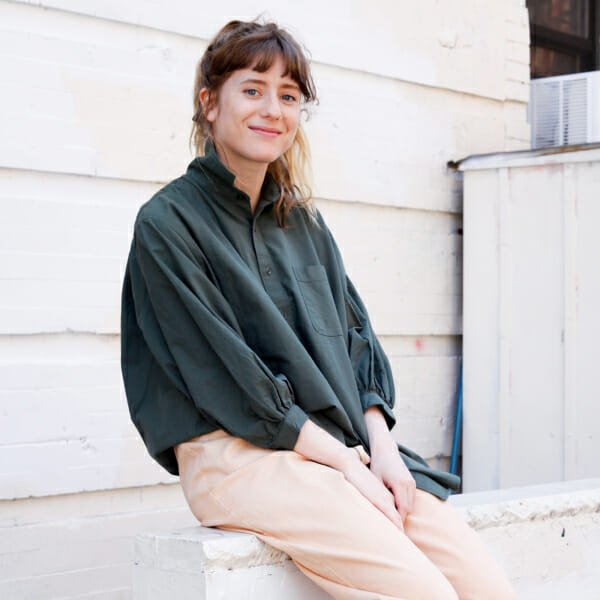 haley nahman green shirt beige pants portrait