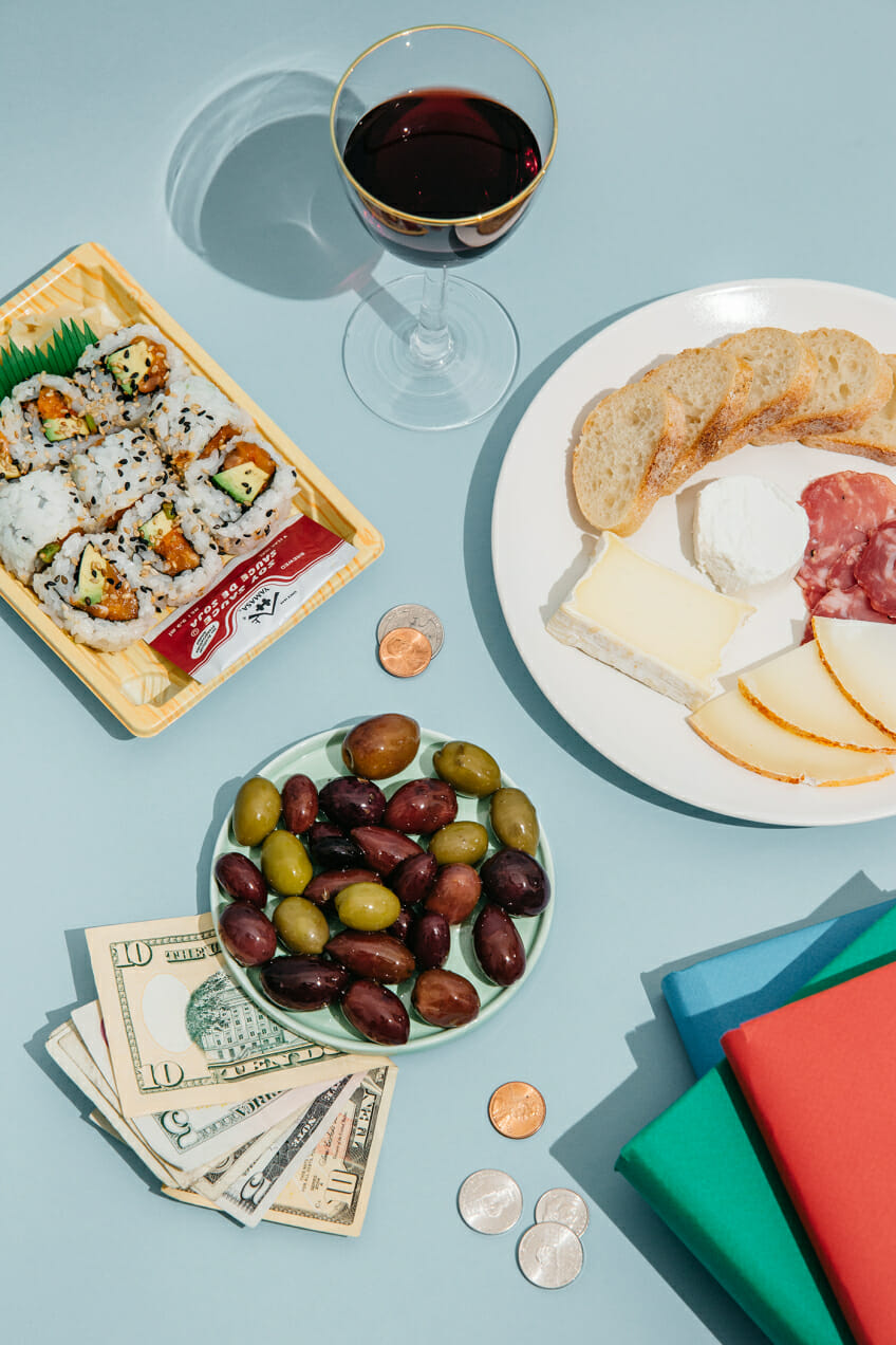 olives cheese plate wine sushi money diary books