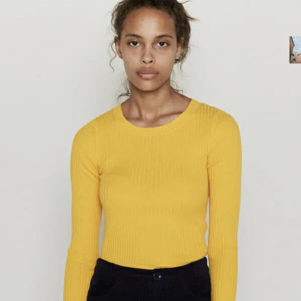 Girl in yellow entire world sweater